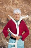 Crone. Shamanic Senior Woman. Portrait of a strong and fierce grandmother holding an Elk antler Stock Photo