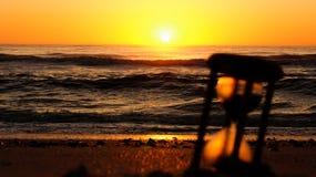 Cronometrare i grani della sabbia durante l'alba Fotografia Stock