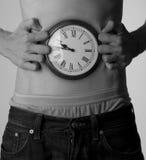 Cronometre em sua barriga, pulso de disparo natural para a fome. Fotografia de Stock