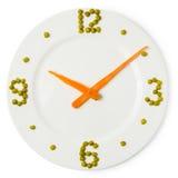 Cronometri dal piatto, dalle carote e dai piselli Fotografie Stock Libere da Diritti