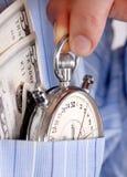 Cronometro con soldi nella casella Immagine Stock