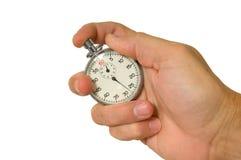 Cronometro della holding della mano fotografie stock libere da diritti