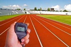 Cronometro nel campo di atletica Fotografie Stock Libere da Diritti