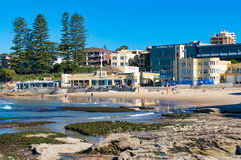 Cronulla beach coastline with people relaxing and doing sports. Sydney, Australia - May 24, 2017: Cronulla beach coastline infrastructure with RSL club and Royalty Free Stock Images