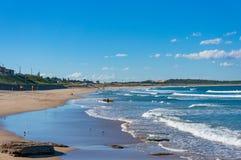 Cronulla beach with unrecognizable surfers stock photos