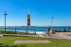 Cronulla suburb with people busy with everyday activities Royalty Free Stock Photos