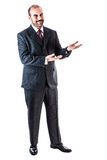 Crook businessman. Portrait of a classy businessman wearing a suit isolated over a white background Stock Photos