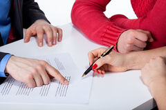 Crook convincing to sign unfair contract. Crook convincing couple to sign unfair contract Royalty Free Stock Photo