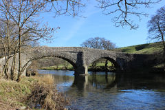 Crook of Lune Bridge near Beckfoot, Cumbria. Narrow bridge called Crook of Lune Bridge on the minor road over the River Lune near Beckfoot and Lowgill in Cumbria Royalty Free Stock Photography