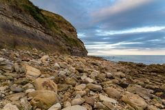Crook Ness, North Yorkshire, UK. Rocky beach and north sea view in Crook Ness near Scarborough, North Yorkshire, UK Royalty Free Stock Image