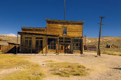 Crooked abandoned western saloon building and shop in Bodie Ghost Town Stock Photography