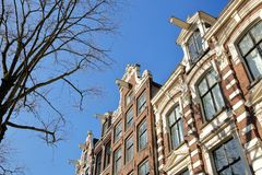 Crooked and colorful heritage buildings, located along Bloemgracht Canal in Jordaan stock image