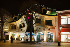 The Crooked House in Sopot. Sopot, Poland - March 07 2016: Night view of the Crooked House on the pedestrian street of Monte Cassino Royalty Free Stock Photography