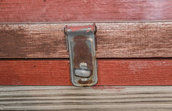 Crooked latch. On an information board Royalty Free Stock Photography