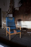 Crooked old chair. Old derelict room in a hostpital with a chair stock illustration