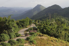 The crooked path over the mountain complex. ETak car Stag climb altitude towards the top of Phu Pa Po The peak of this mountain Royalty Free Stock Images