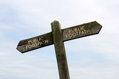A crooked public footpath sign Royalty Free Stock Photography