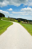 Crooked road in the country Royalty Free Stock Images