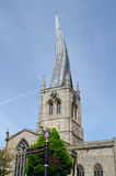 Crooked Spire with Road Signs Royalty Free Stock Image