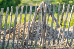 A crooked wooden fence. stock photo