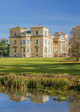 Croome Court, Worcestershire. Croome Court, a Neo-Palladian designed house and the Croome River on a sunny autumn day. `Capability` Brown originally landscaped stock images