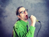 Crooner in green shirt and necktie Royalty Free Stock Image