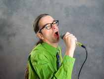 Crooner in green shirt and necktie Stock Image