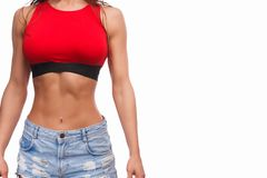 Crop adult female with perfect abs stock image