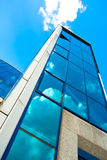 Crop of blue glass wall of skyscraper Stock Photo