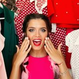 Frustreted brunette in pink having a problem of choosing clothes. Crop, closeup portrait of young girl in pink blouse waching on camera and holding hands royalty free stock photos