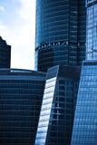 Crop of dark blue modern skyscrapers Stock Images