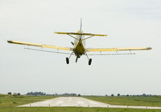 Crop Duster. Prepares to land stock photo