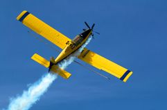 Crop Duster. At work applying chemicals to field Stock Photos