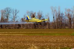 Crop Duster. At work applying chemicals to field Royalty Free Stock Photo