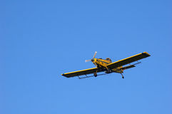 Crop duster. A crop dusting plane in flight stock image