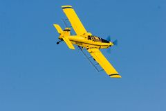 Crop Duster. Low flying crop duster over a field in Eastern Colorado Stock Image
