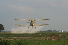 Crop Duster. Photo of crop duster taken over a rice field royalty free stock images