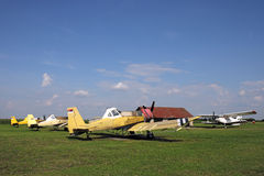 Crop duster airplanes on airfield Stock Photos