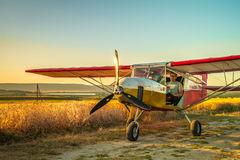 A crop duster applies chemicals to a field. royalty free stock photography