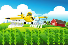 Crop duster flying over a field Stock Photography