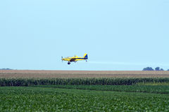 Crop duster. Spraying corn and soy bean field, Illinois USA royalty free stock image