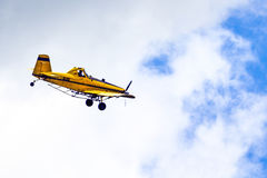 Crop Duster. A crop duster spraying crops stock images