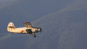 Crop duster spraying crops from the air Royalty Free Stock Image