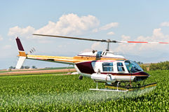Crop Duster Spraying a Field Stock Images