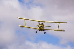 Crop duster spraying fields Stock Images