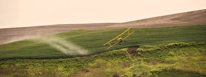 Crop dusting airplane Stock Photos