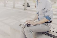 Crop man with laptop stock photography
