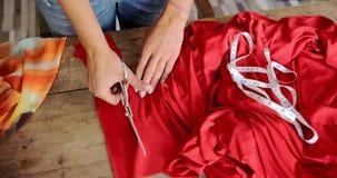 Crop female cutting fabric stock video footage