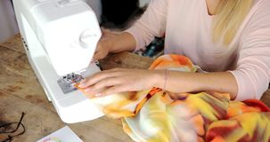 Crop female sewing stock footage