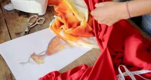 Crop female using cloth sketch stock footage